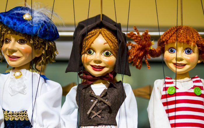 Row of traditional puppets